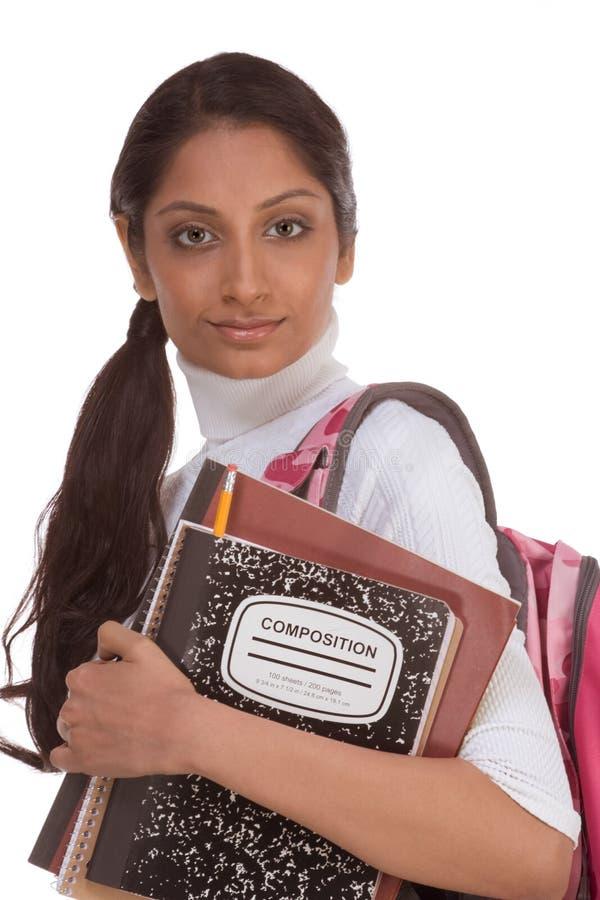 Giovane donna indiana dello studente di college con lo zaino immagine stock libera da diritti