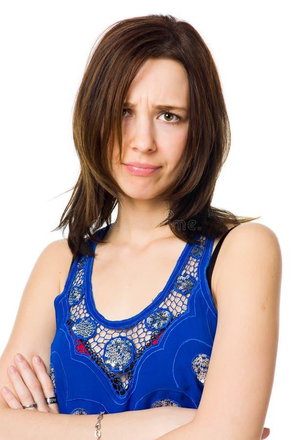 Giovane donna infelice isolata su backgound bianco fotografia stock