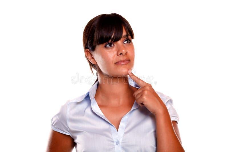 Giovane donna ispanica Pensive che osserva in su fotografia stock libera da diritti