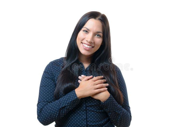 Giovane donna le che mostra ringraziamento sincero immagini stock