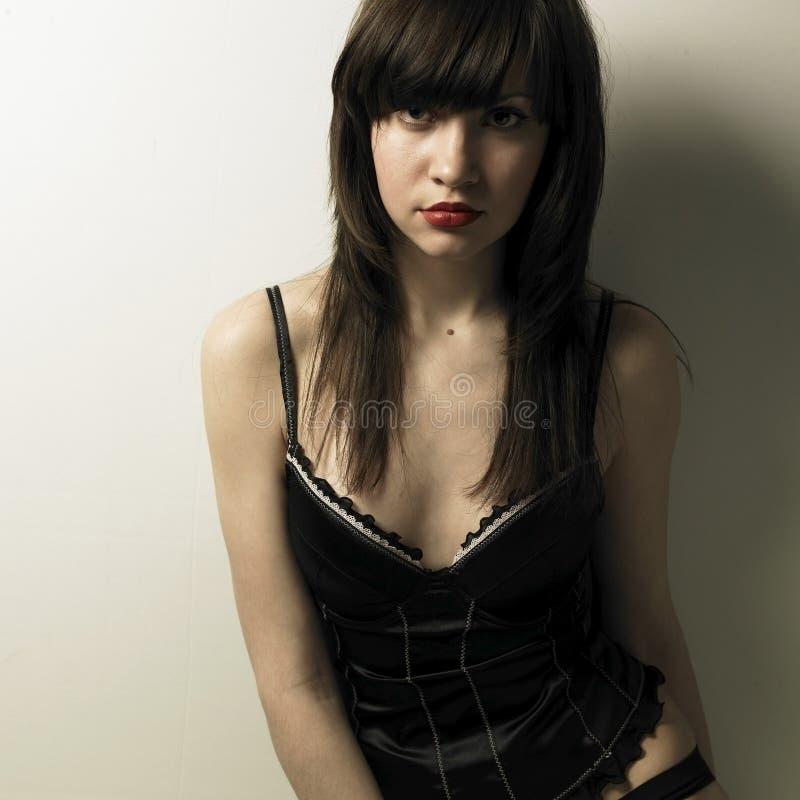 Giovane donna magnifica in corsetto fotografia stock