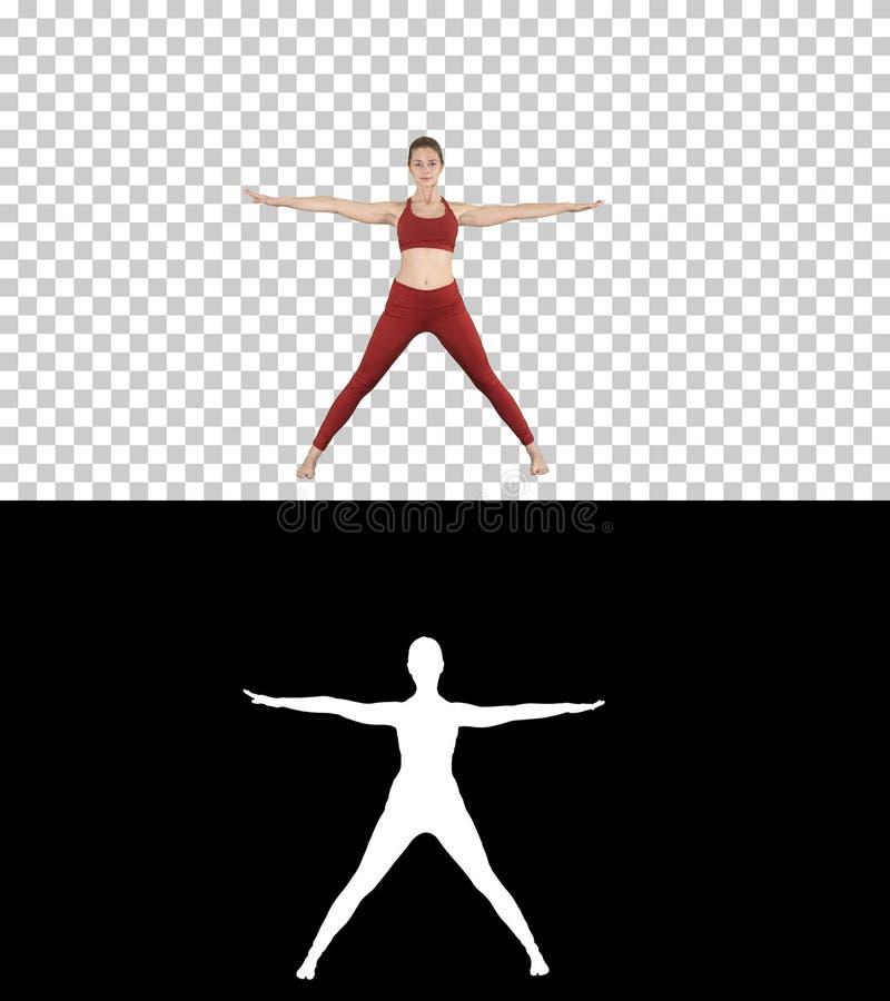 Giovane donna nella posa di piegamento di andata di yoga di asana, alfa canale fotografia stock