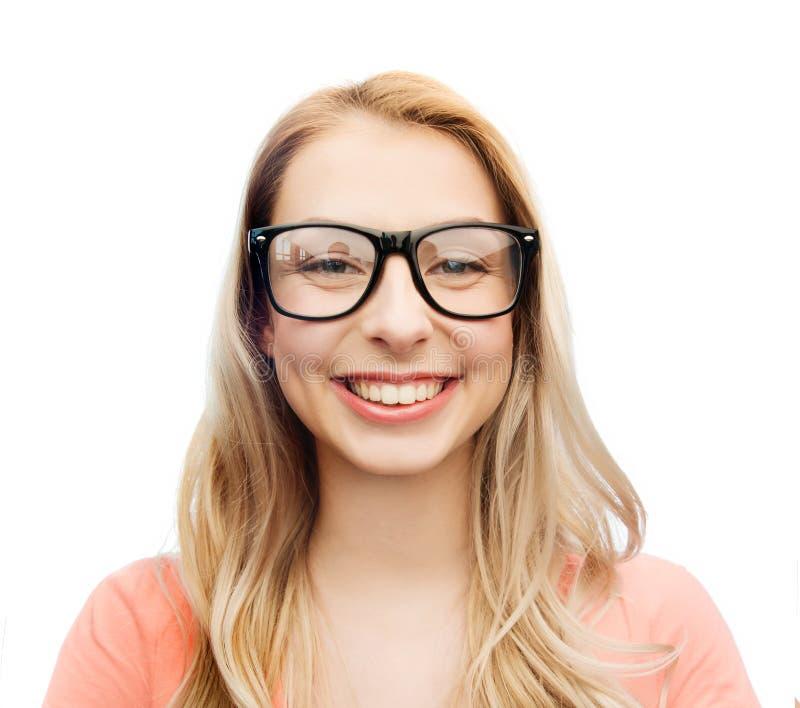 Giovane donna o adolescente felice in occhiali immagini stock libere da diritti
