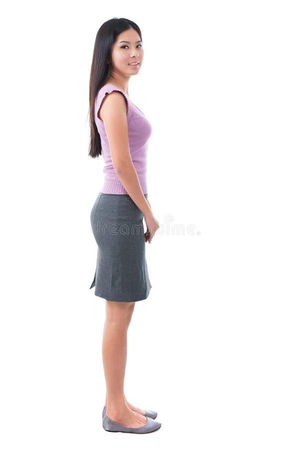 Giovane donna piena dell'asiatico di vista laterale del corpo immagini stock libere da diritti