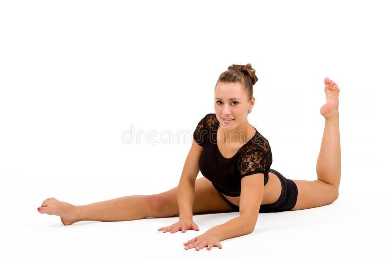 Giovane donna professionale della ginnasta fotografie stock libere da diritti