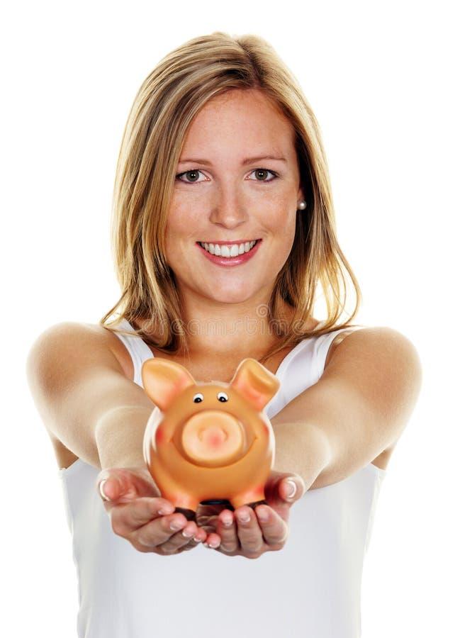 Giovane donna, risparmiare soldi fotografie stock