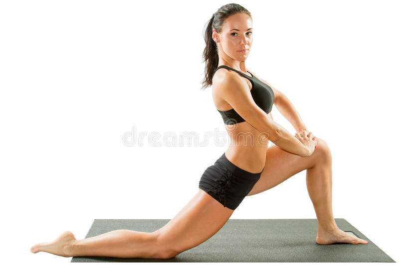 Giovane donna sexy di yoga che fa esercizio yogic sull'isolato su fotografia stock libera da diritti