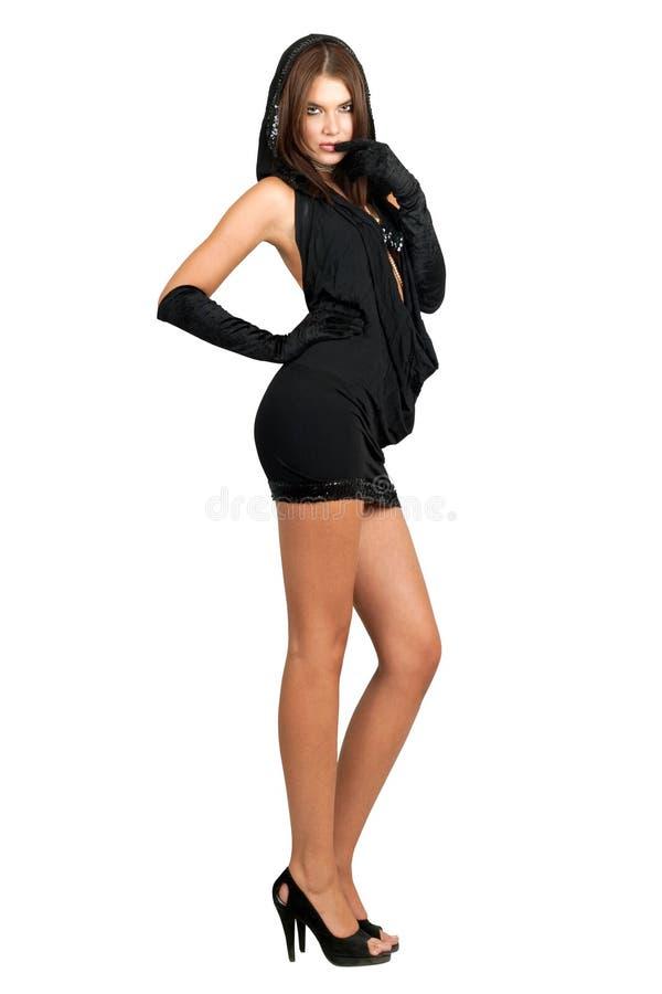 Giovane donna sexy nei dres neri fotografia stock