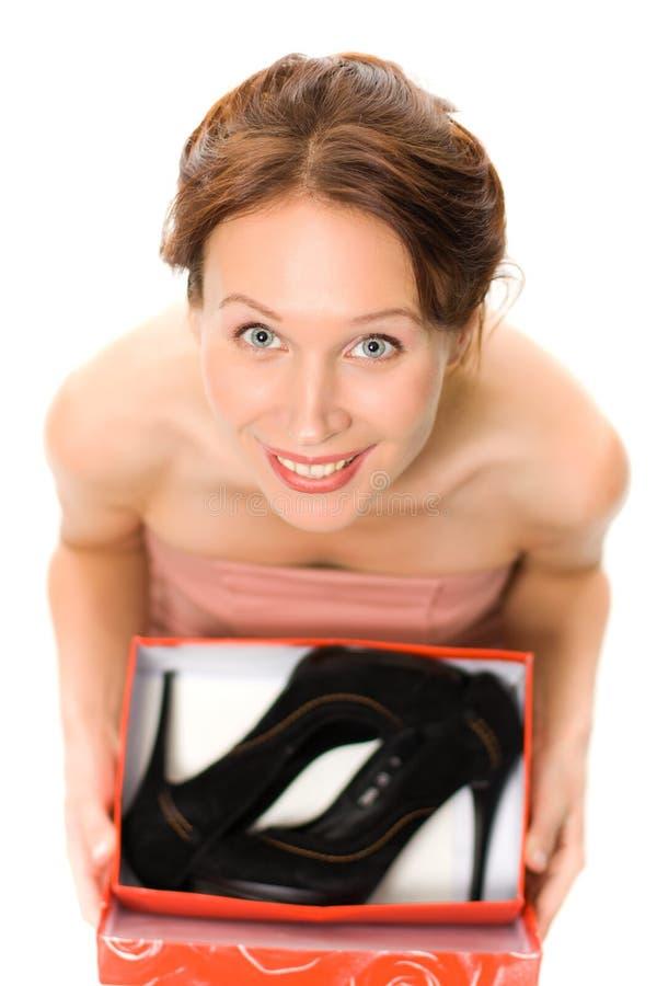 Donna con le scarpe. immagini stock