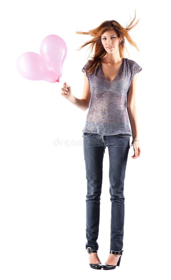 Giovane donna sottile con gli aerostati fotografia stock