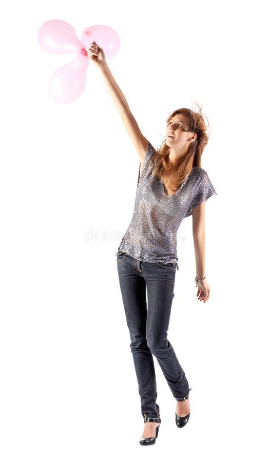 Giovane donna sottile con gli aerostati immagini stock