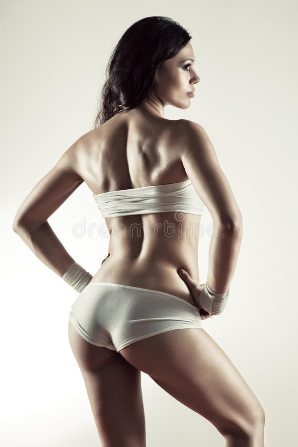 Giovane donna sportiva sexy fotografie stock