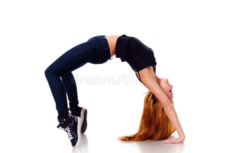 Giovane donna sulla punta dei piedi immagine stock