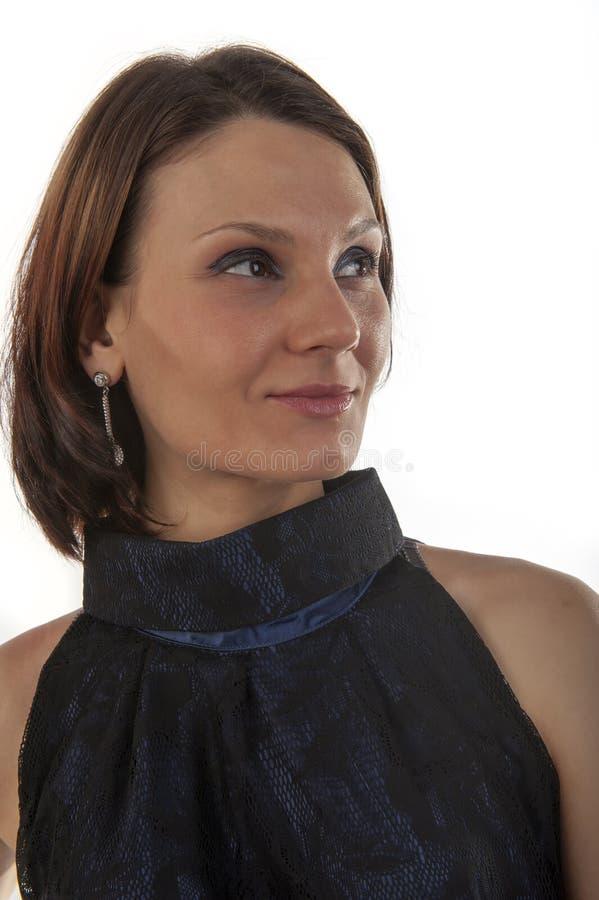 Giovane donna in un vestito blu immagini stock libere da diritti