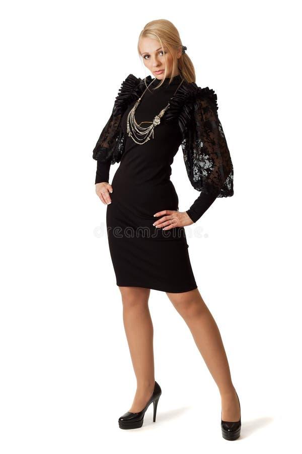 Giovane donna in vestito da cocktail. immagine stock libera da diritti