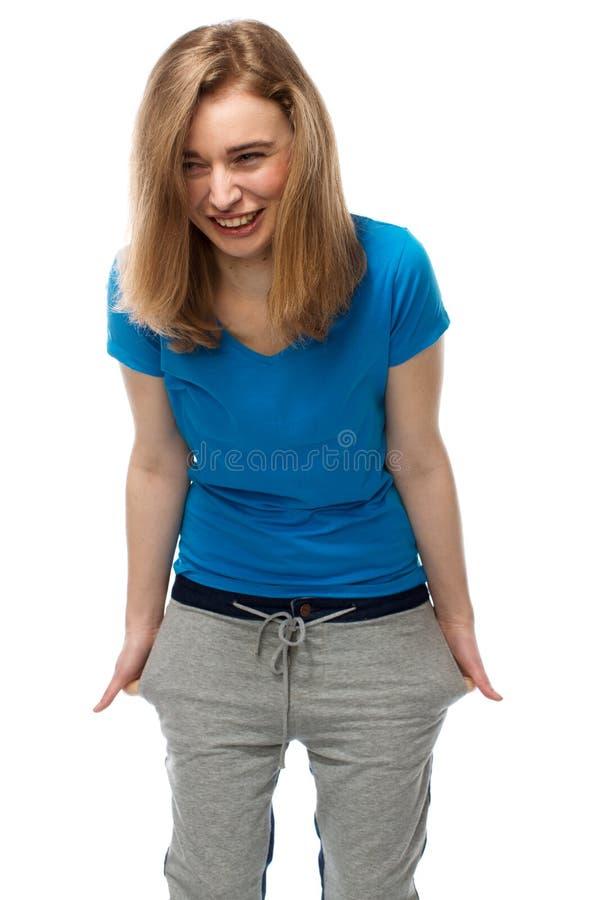 Giovane donna vivace che sta ridente fotografia stock libera da diritti
