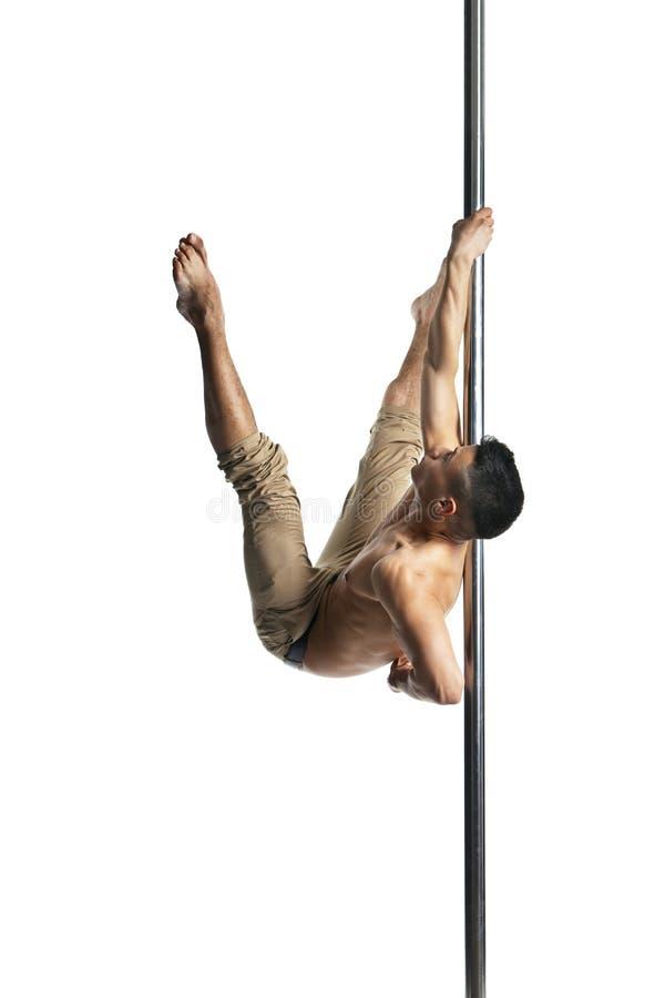 Giovane forte uomo di ballo del palo isolato fotografie stock libere da diritti