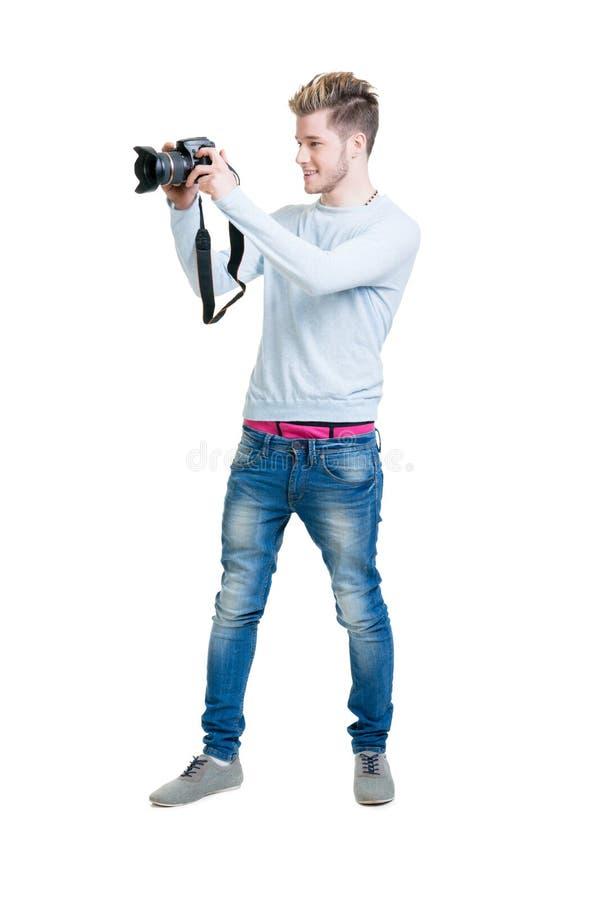 Giovane fotografo che tiene una macchina fotografica della foto immagine stock