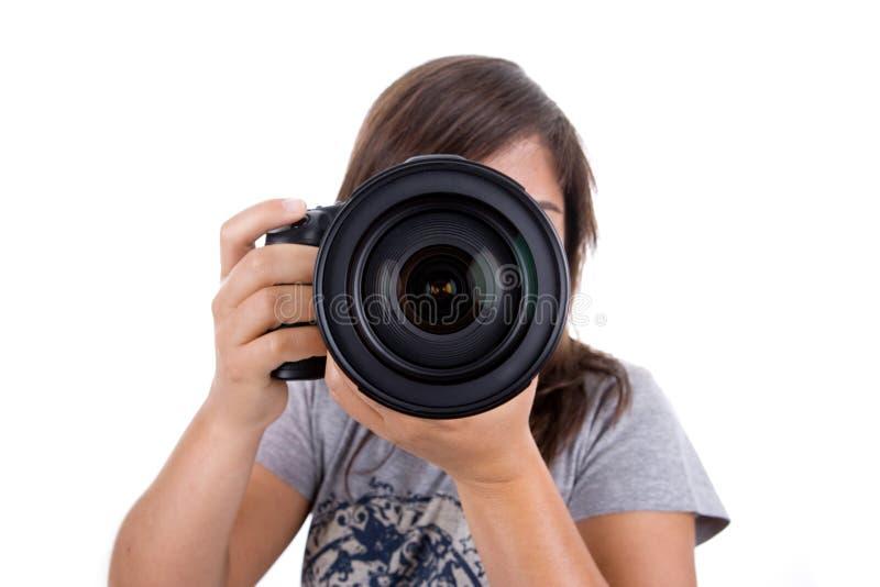 Giovane fotografo femminile isolato su bianco immagini stock