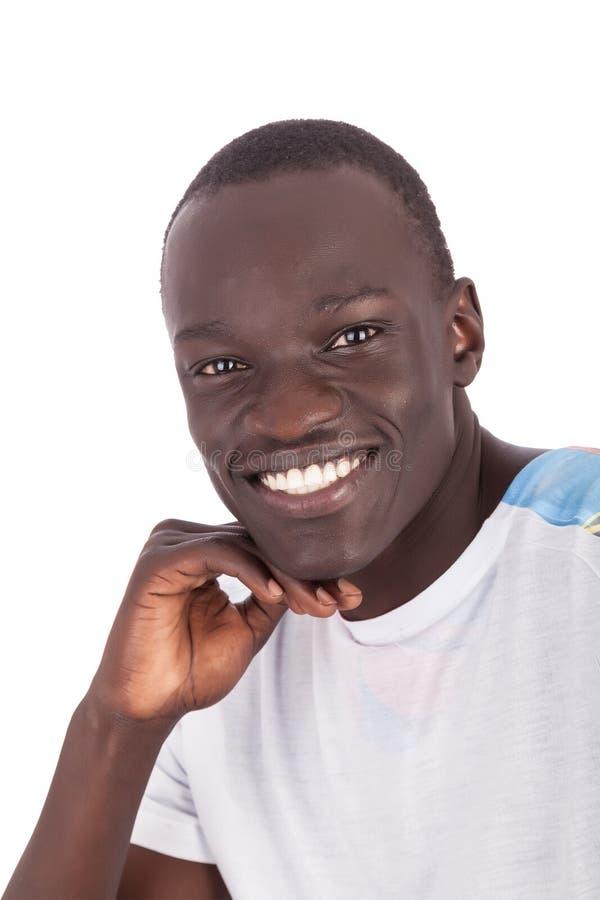 Giovane fronte sudanese bello dell'uomo alla macchina fotografica immagini stock