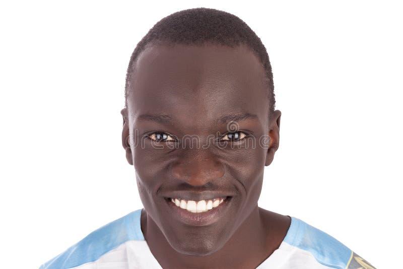 Giovane fronte sudanese bello dell'uomo alla macchina fotografica fotografia stock