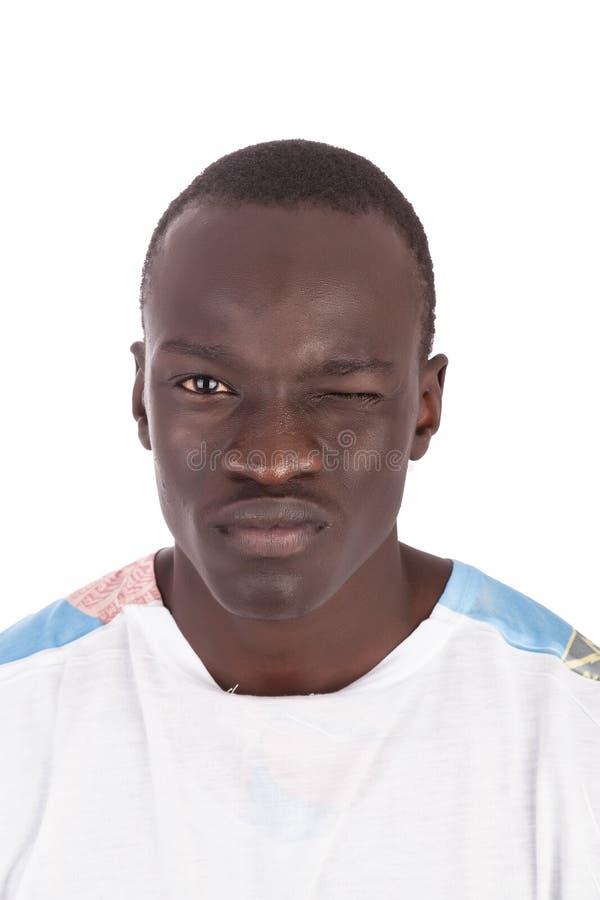 Giovane fronte sudanese bello dell'uomo alla macchina fotografica fotografia stock libera da diritti