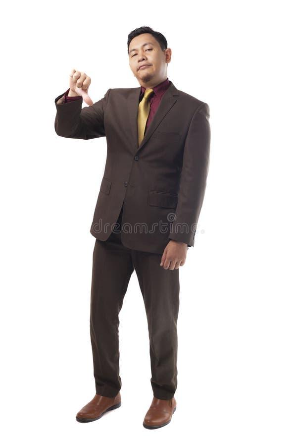 Giovane gesto asiatico di Shows Thumb Down dell'uomo d'affari immagini stock
