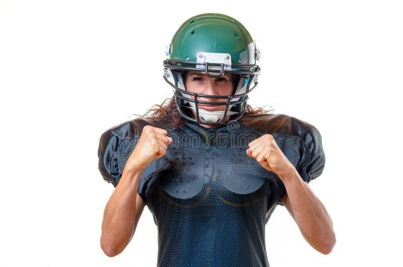 Giovane giocatore di football americano femminile messo a fuoco motivato fotografie stock libere da diritti