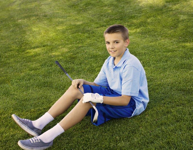 Giovane giocatore di golf adolescente immagini stock