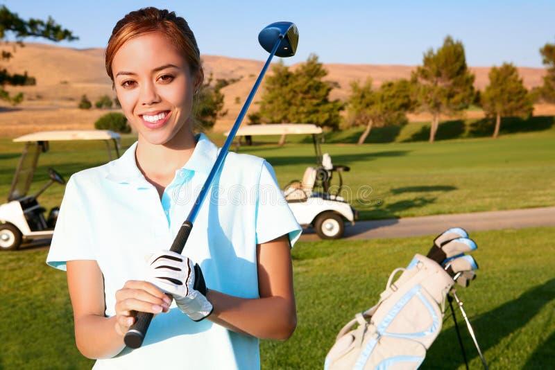 Giovane giocatore di golf grazioso della donna fotografie stock