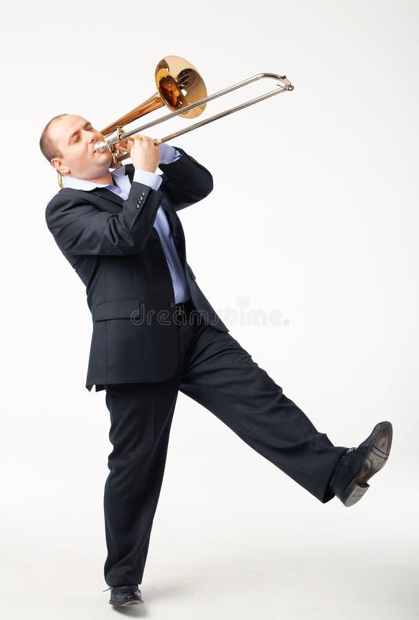 Giovane giocatore di Trombone fotografia stock