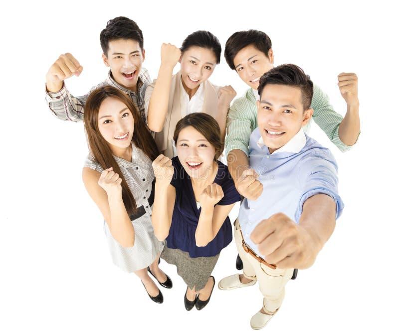 Giovane gruppo felice di affari con il gesto di successo immagini stock