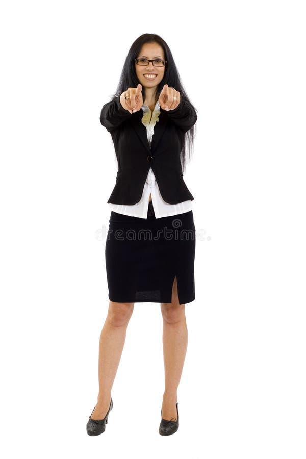 Giovane indicare sorridente della donna di affari fotografie stock