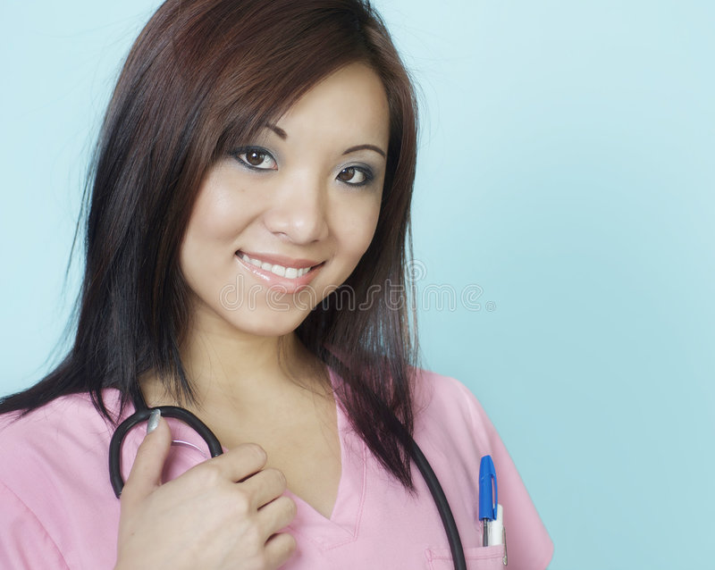 Giovane infermiera di allievo sorridente attraente immagine stock libera da diritti