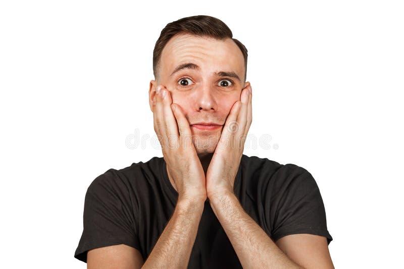 Giovane mano triste della tenuta una dell'uomo - una guancia, isolate su fondo bianco fotografie stock libere da diritti