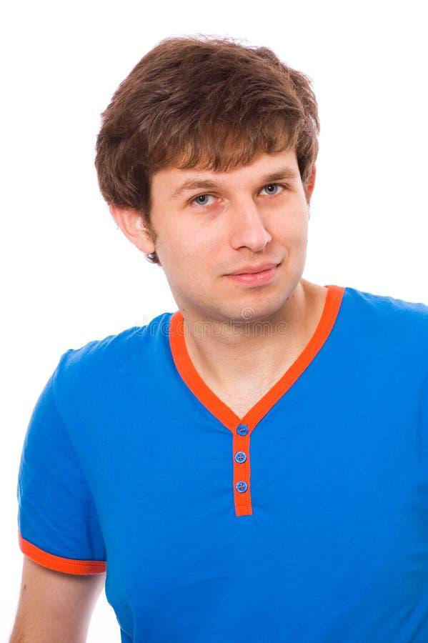 Giovane maschio in camicia blu, positivo e sicuro immagini stock
