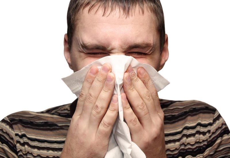 Giovane maschio che ha un freddo o un'allergia immagine stock libera da diritti