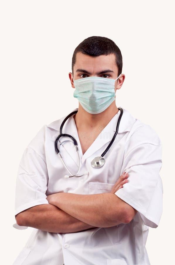 Ritratto di giovane medico con la maschera e lo stetoscopio immagine stock