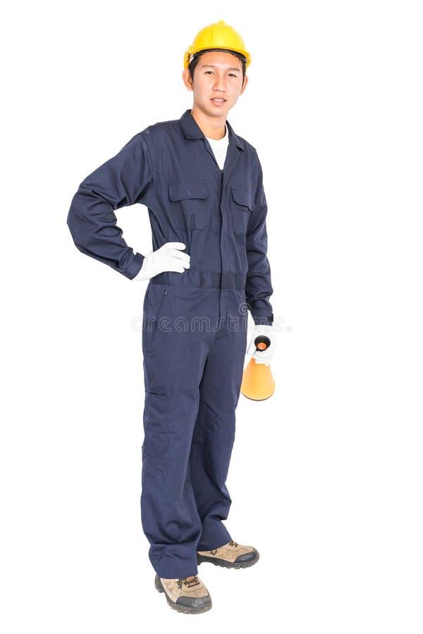 Giovane operaio con il casco giallo che tiene un megafono immagini stock libere da diritti