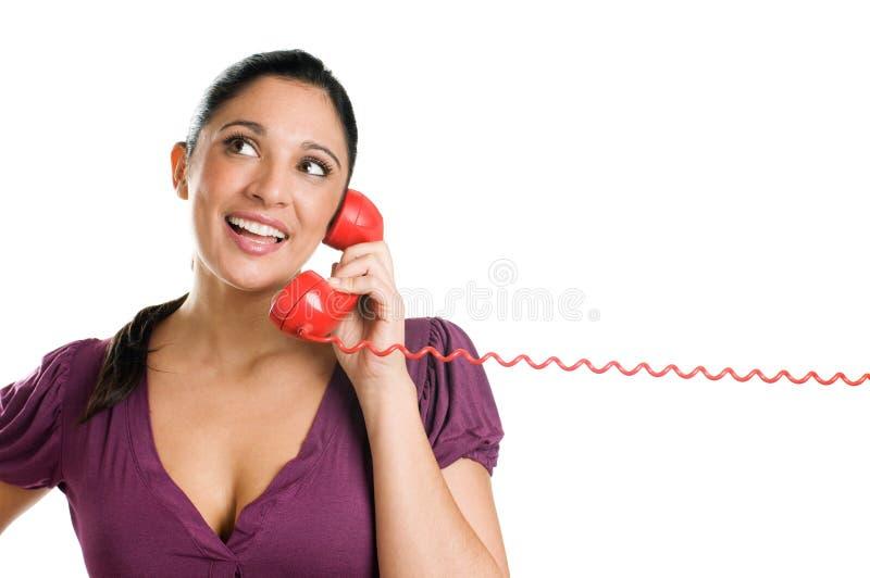Giovane operatore di sogno su una chiamata di telefono fotografie stock