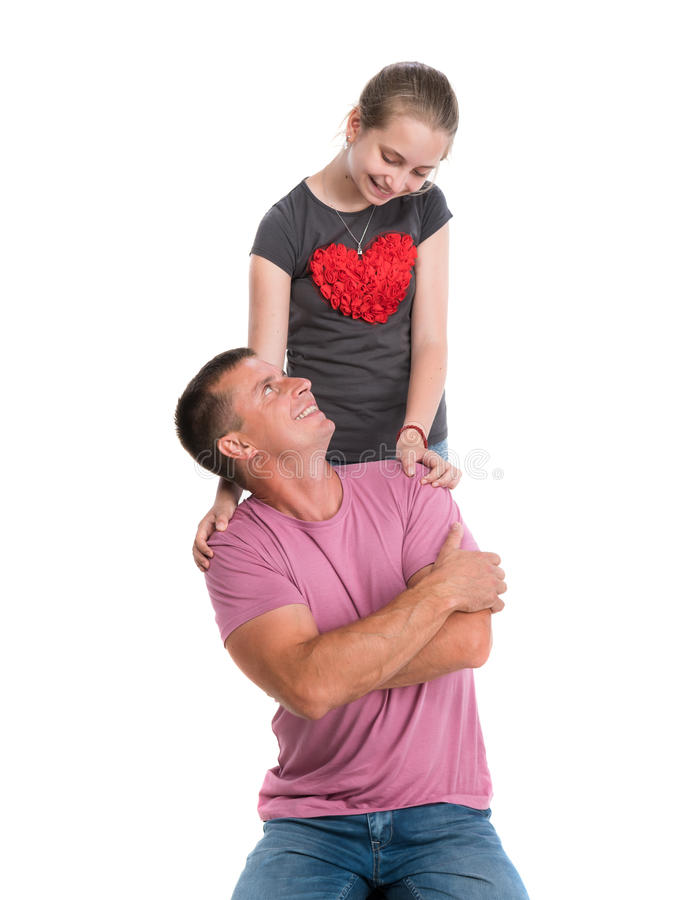 Giovane padre con la figlia sorridente fotografia stock