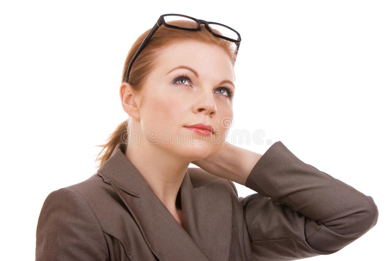 Giovane pensiero della donna di affari immagini stock libere da diritti