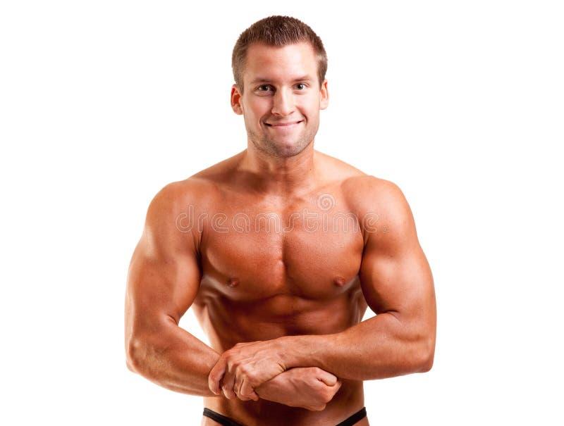 Giovane posizione del bodybuilder fotografia stock