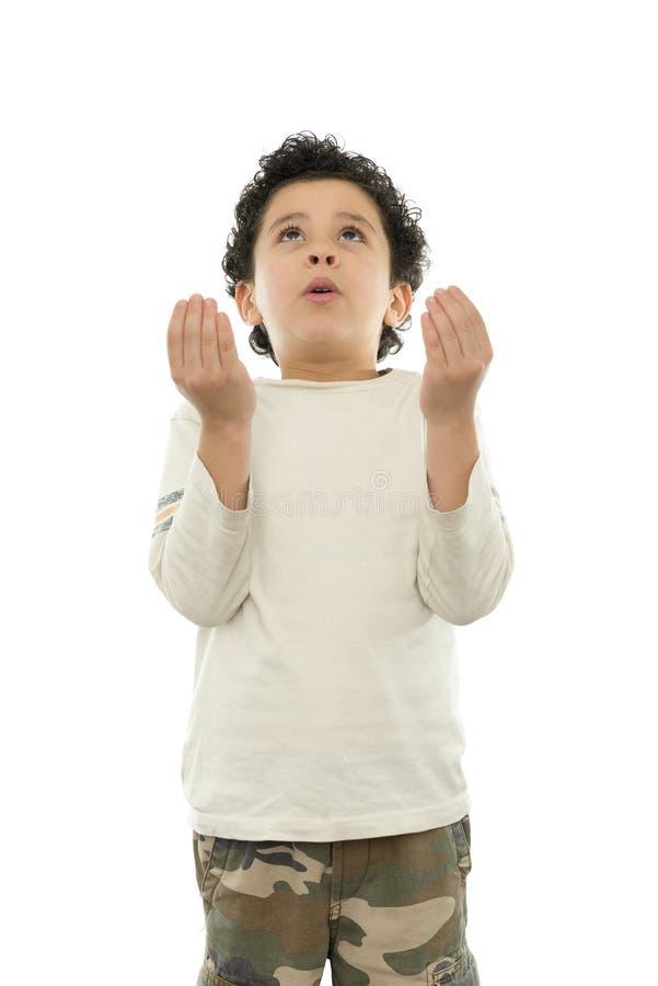 Giovane pregare del ragazzo fotografie stock libere da diritti