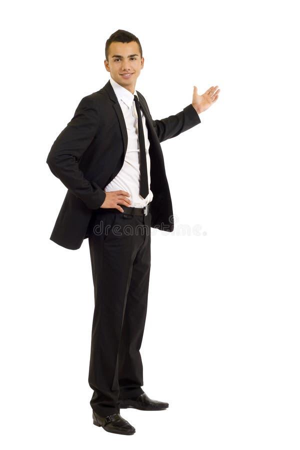 Giovane presentazione dell'uomo di affari immagine stock