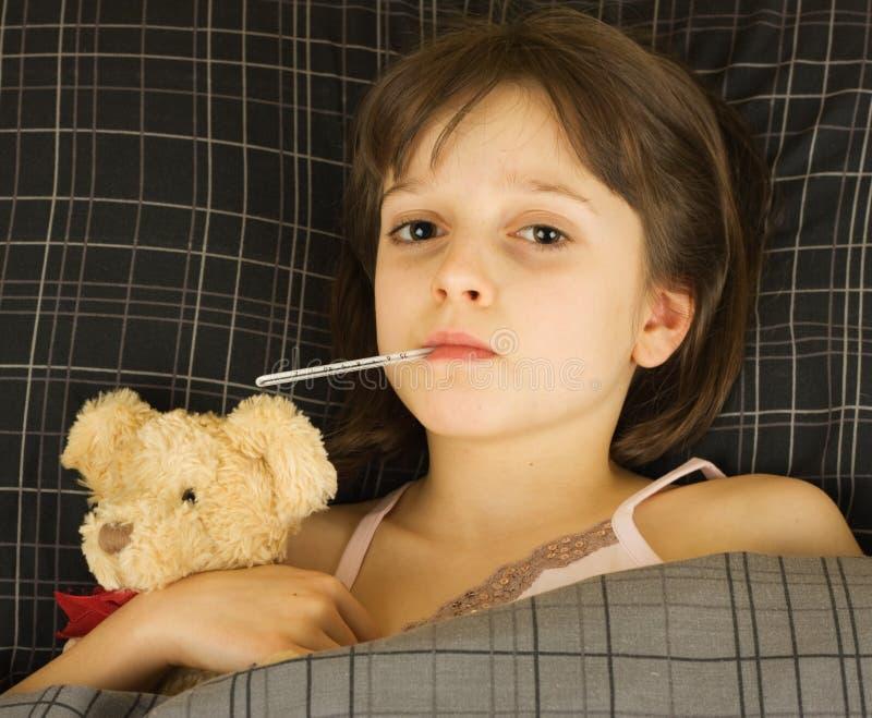 Giovane ragazza ammalata fotografia stock