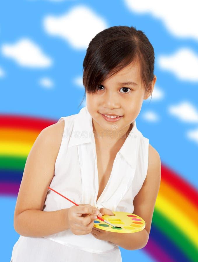 Giovane ragazza artistica con un insieme della vernice immagine stock libera da diritti