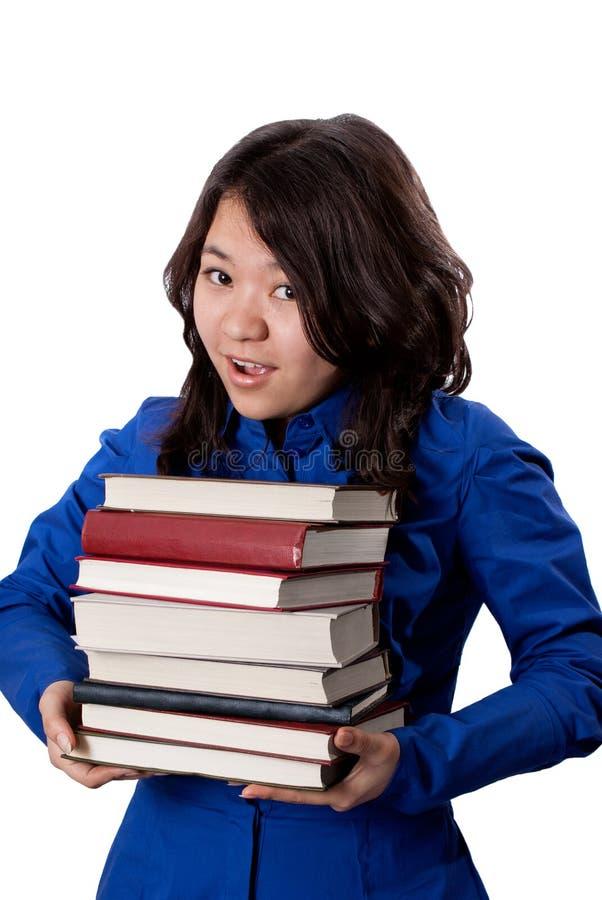 Giovane ragazza asiatica con i libri fotografie stock libere da diritti
