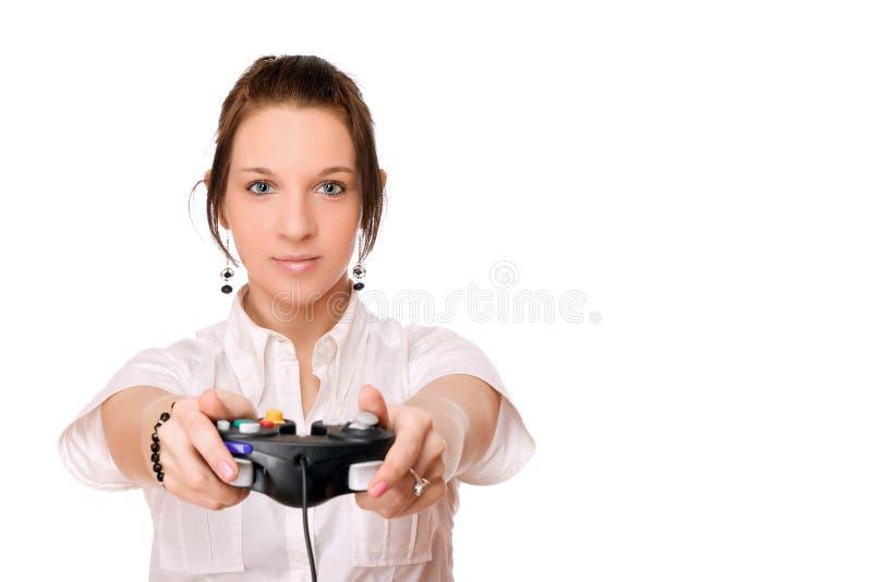 Giovane ragazza del brunette con una barra di comando fotografia stock