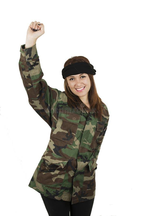 Giovane ragazza felice vestita in cammuffamento verde fotografia stock libera da diritti